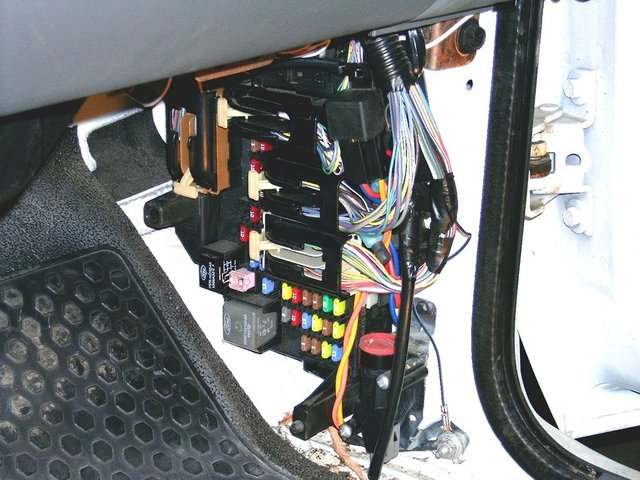 it is located behind the p/s kick panel  once you have the kick panel  removed, locate the black connectors that you will need to tap into
