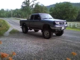 (All jacked up) My 1997 ford ranger xlt extended cab..
