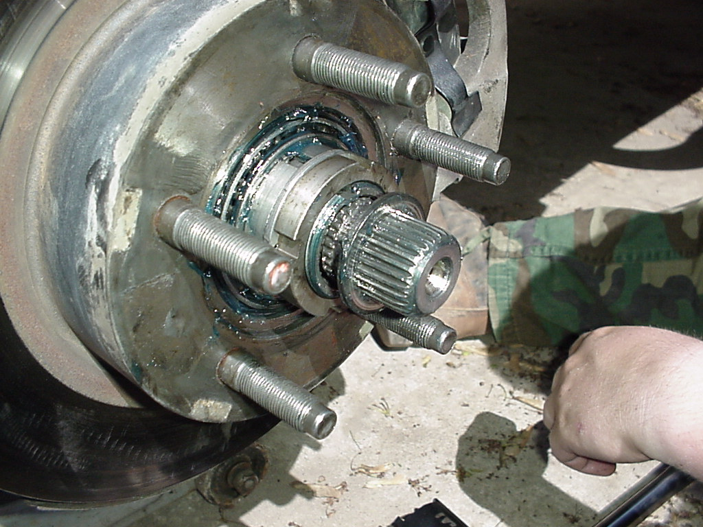 Now, install the toothed washer on the shaft, past the ring groove in the  axle. You may have to pull the axle shaft out by hand to get it all the way  ...